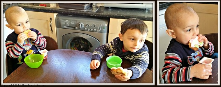 Aidan (right) is eating the cookie in style – dipped into yogurt!