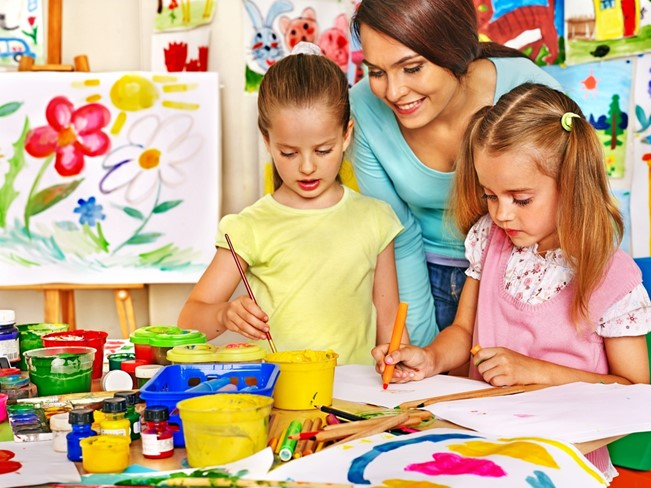 Mother painting with children