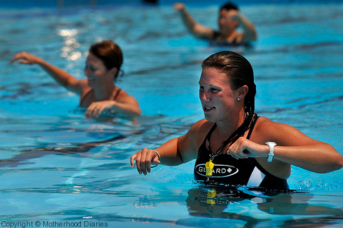 Pregnant woman exercising in the pool