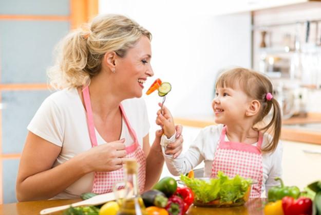 Mum and child eating veggies