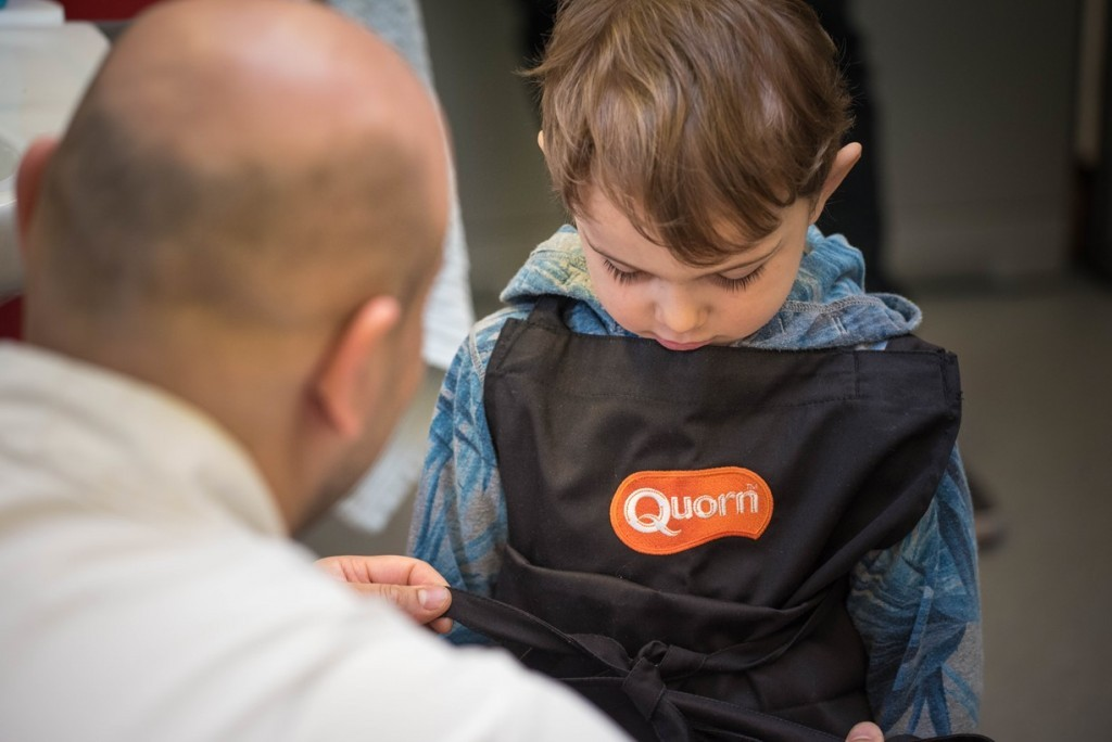 Wearing Quorn apron - Kids Cookery School - motherhooddiaries.com