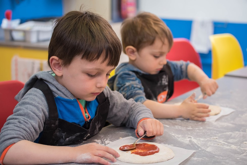 Tomato sauce on Quorn pizza - Quorn Kids Cookery School - motherhooddiaries.com