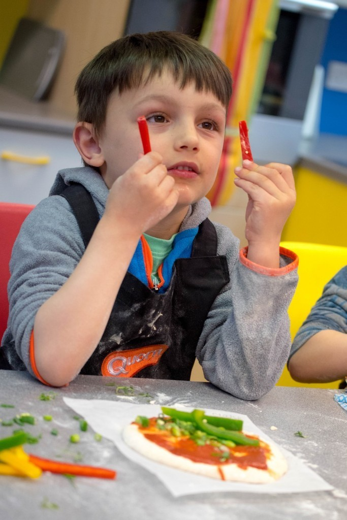Topping on Quorn pizza - Quorn Kids Cookery School - motherhooddiaries.com