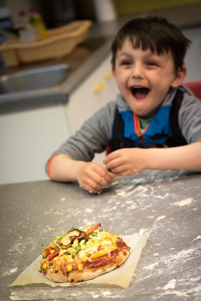 Aron enjoying his pizza creation - Quorn Kids Cookery School - motherhooddiaries.com