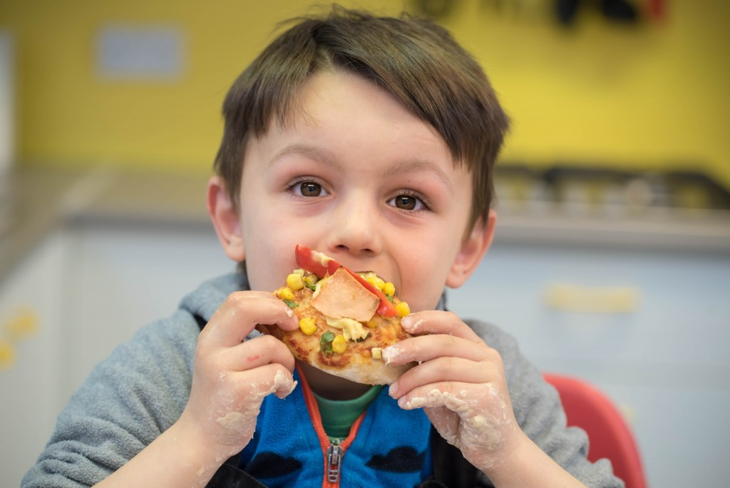 Aron enjoying his Quorn pizza - Quorn Kids Cookery School - motherhooddiaries.com