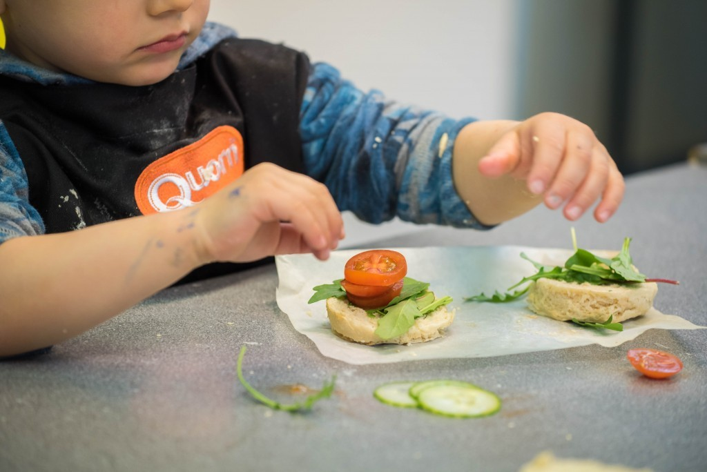 Garnishing the burger buns- Quorn Kids Cookery School - motherhooddiaries.com