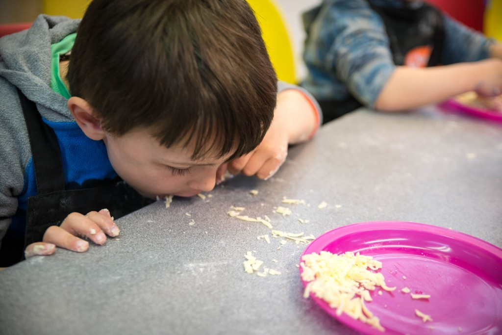 Aron eating cheese off table - Quorn Kids Cookery School - motherhooddiaries.com