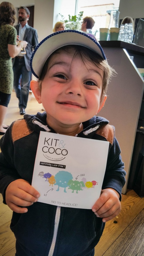 Aidan holding a Kit & Coco product information leaflet - motherhooddiaries