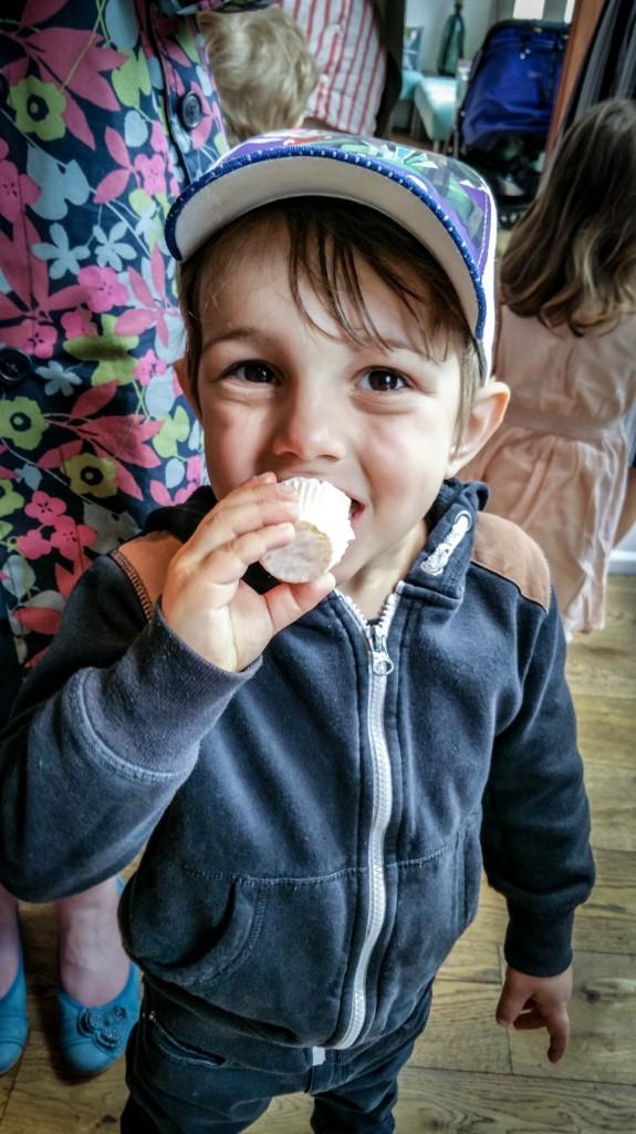 Aidan enjoying Kit & Coco cupcakes at event - motherhooddiaries