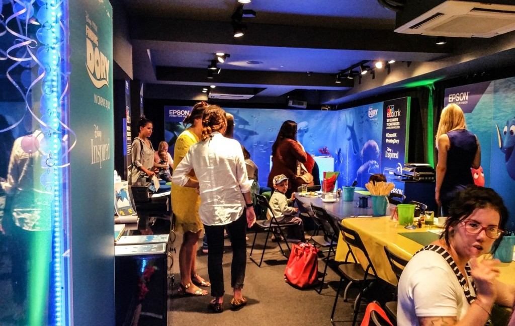 Bloggers hanging around the table at Disney Store Epson event