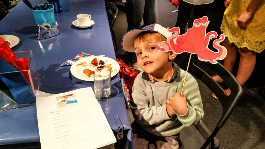 Aidan holding up Hank the Octopus prop at Disney store #PrintingDory Epson event - motherhooddiaries
