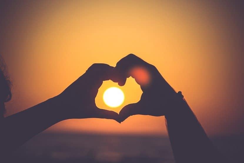 Hands over sun in a heart - motherhooddiaries