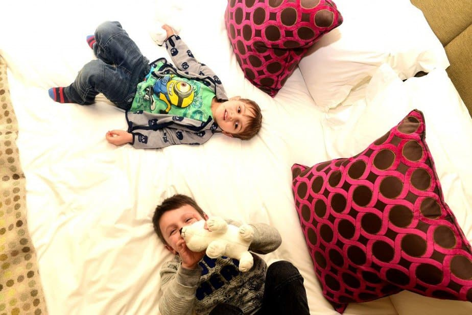 Boys lying on the bed - Arch London Hotel - motherhooddiaries