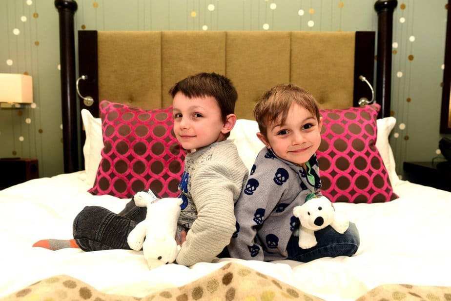 Boys sitting on the bed - Arch London - motherhooddiaries