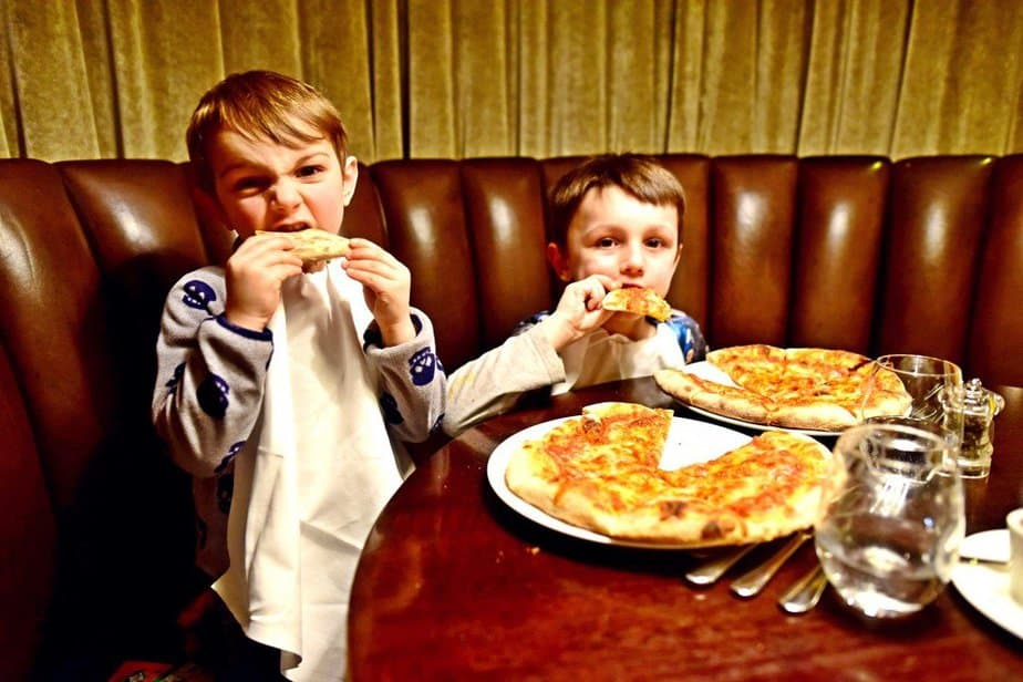 Boys eating Margherita - Arch London Hotel - motherhooddiaries