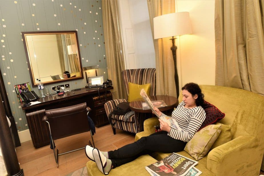 Sitting reading the paper - Arch London Hotel - motherhooddiaries