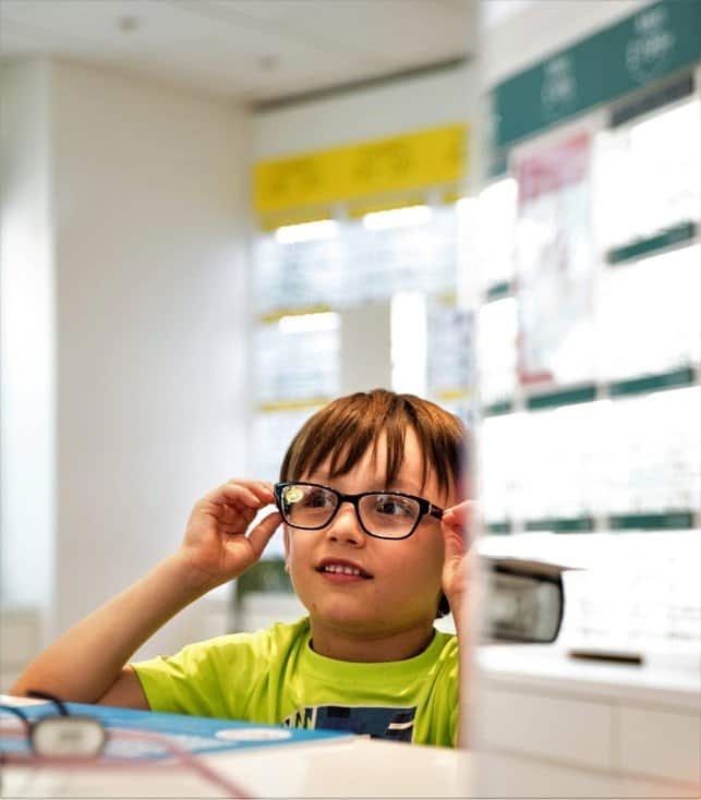 Aron trying frames - Protect your children's eyes this summer with Vision Express' new range of kids' sunglasses - motherhooddiaries