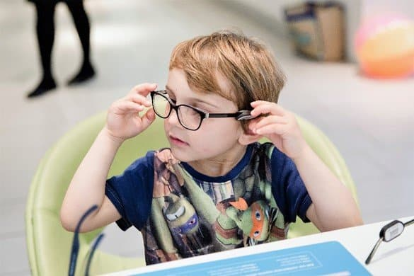 Aidan trying glasses - Protect your children's eyes this summer with Vision Express' new range of kids' sunglasses - motherhooddiaries