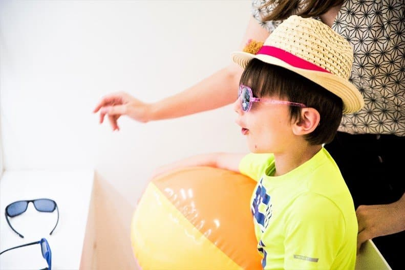 Aron looking at sunglasses range - Protect your children's eyes this summer with Vision Express' new range of kids' sunglasses - motherhooddiaries