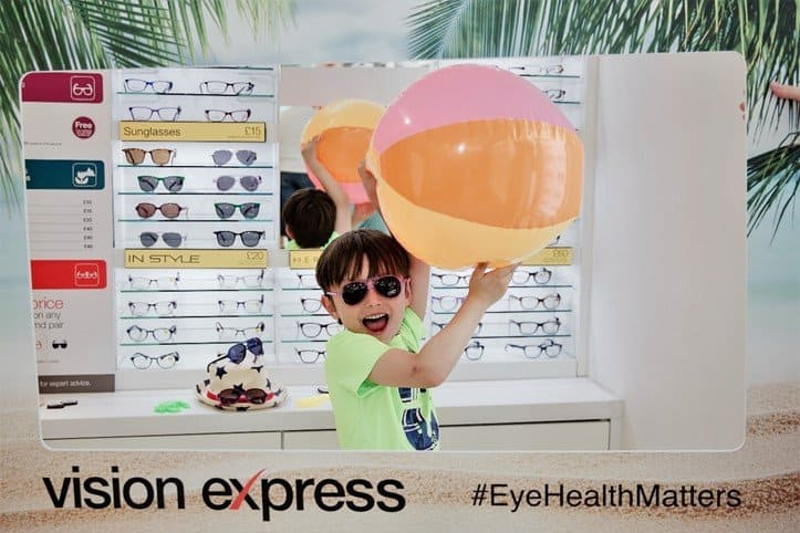 Aron posing with Beach ball and sunglasses range - Protect your children's eyes this summer with Vision Express' new range of kids' sunglasses - motherhooddiaries