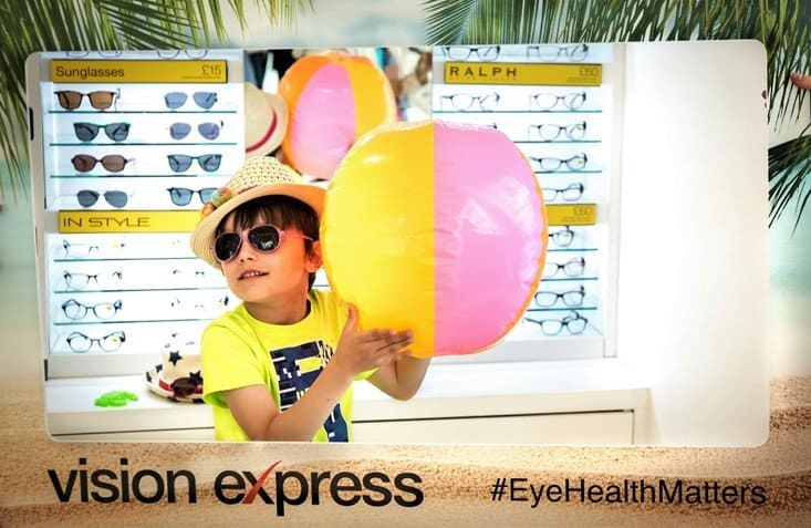 Aron posing with sunglasses range and beach ball - Protect your children's eyes this summer with Vision Express' new range of kids' sunglasses - motherhooddiaries