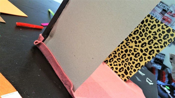 Glue the bottom of the felt paper to the bottom of the sides of the house - Craft Merrily Easy Halloween Monster House - motherhooddiaries