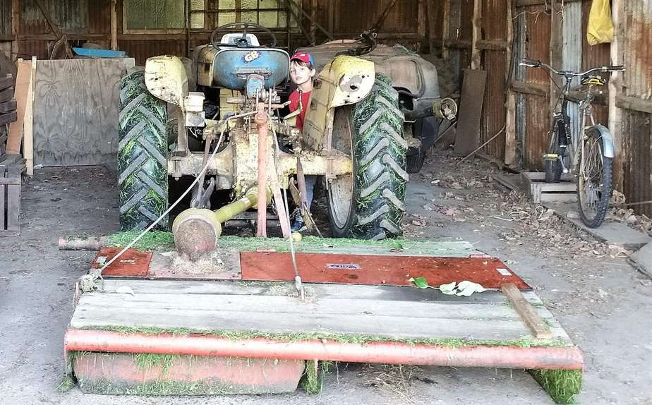 Aron intrigued by the farm's large tractor - motherhooddiaries