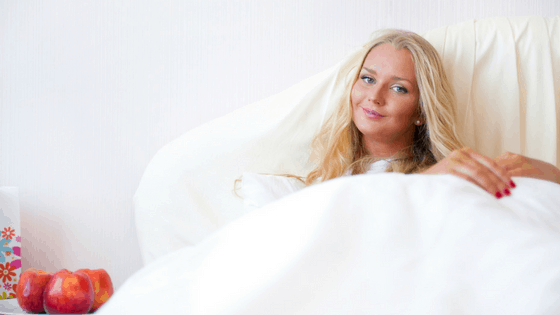 Woman resting in bed