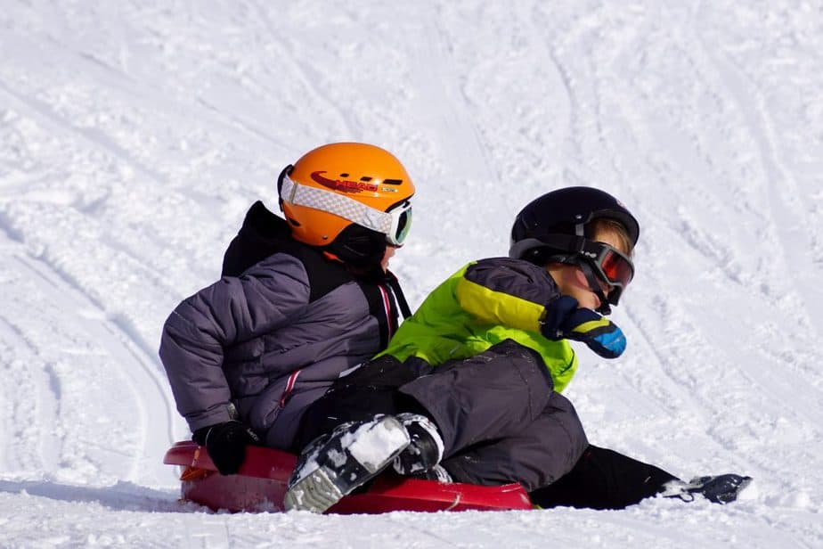 Kids snowboarding in the snow
