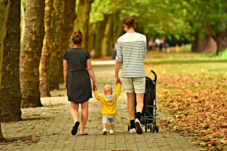 Mother and father walking with baby