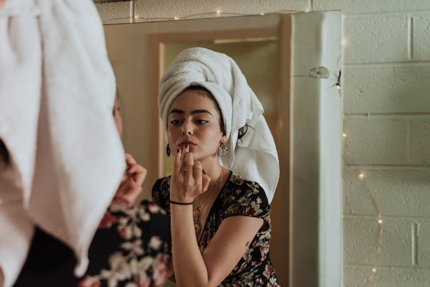 Lady getting ready with towel on her head