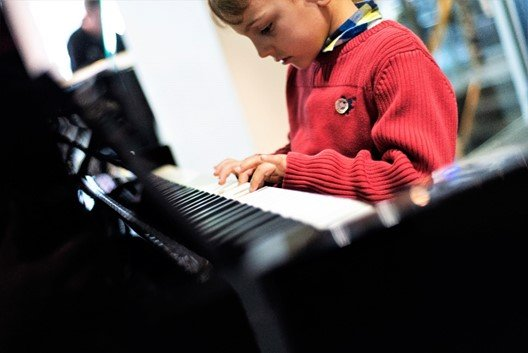 Aidan playing Yamaha keyboard at Yamaha Music London store in Soho