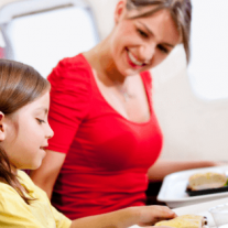 mother and child on plane eating food