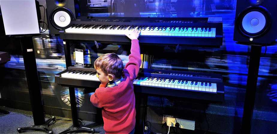 Aidan playing double keyboard at Yamaha Music London store in Soho