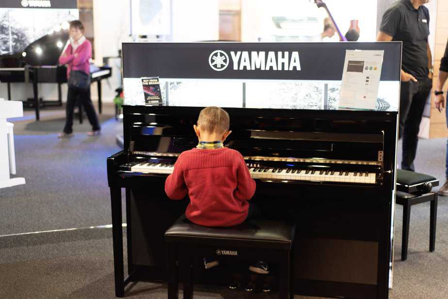 Aidan playinig Yamaha keyboard at Yamaha Music London store in Soho