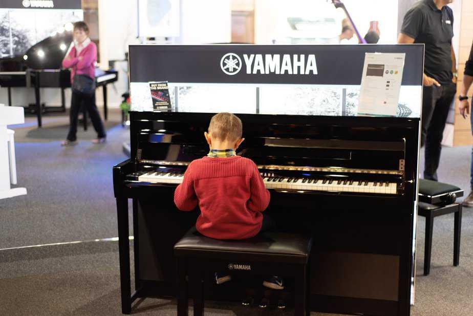 Aidan playinig Yamaha keyboard at Yamaha Music London store in Soho