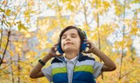 Boy listening headphones to music