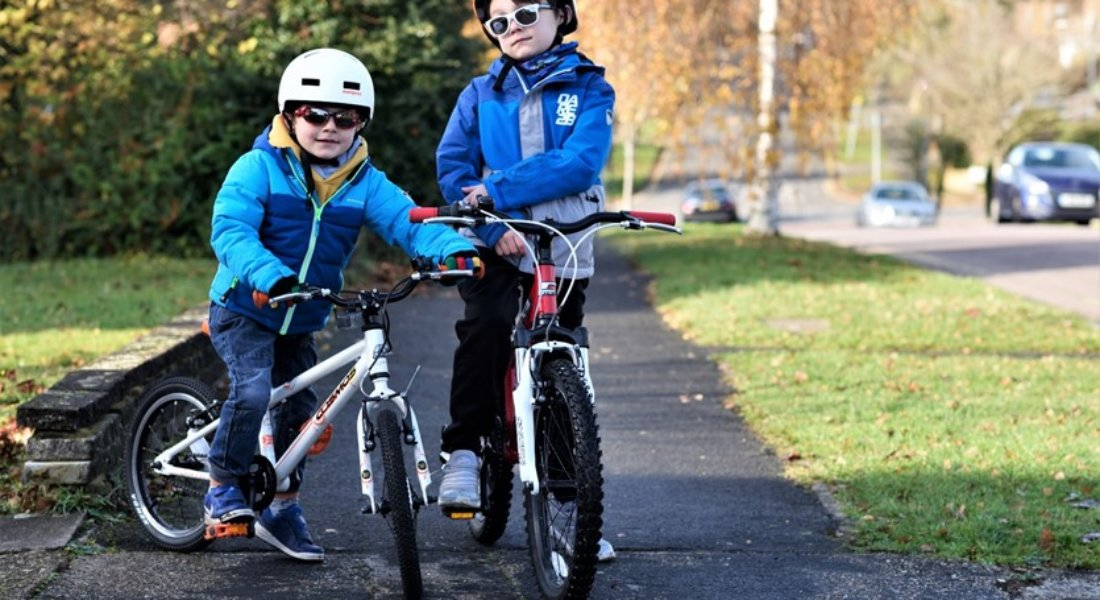Boys on their bikes outside