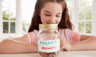 Child with pocket money jar