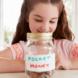 Child with pocket money jar