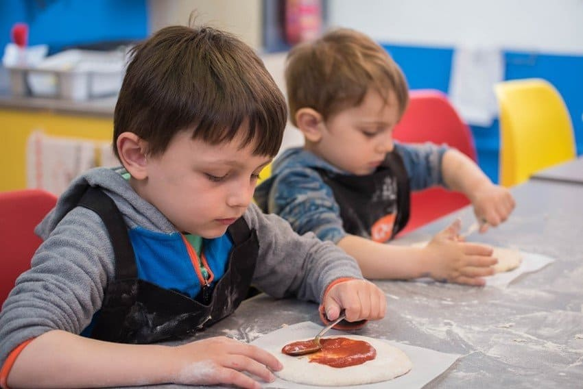 Boys making pizza at Kids Cookery School