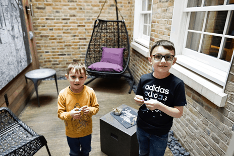 Boys enjoying the outside terrace - Juniper suite - The Arch - Photo by https://www.prestonperfectphotography.com/