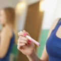 Woman holding pregnancy test